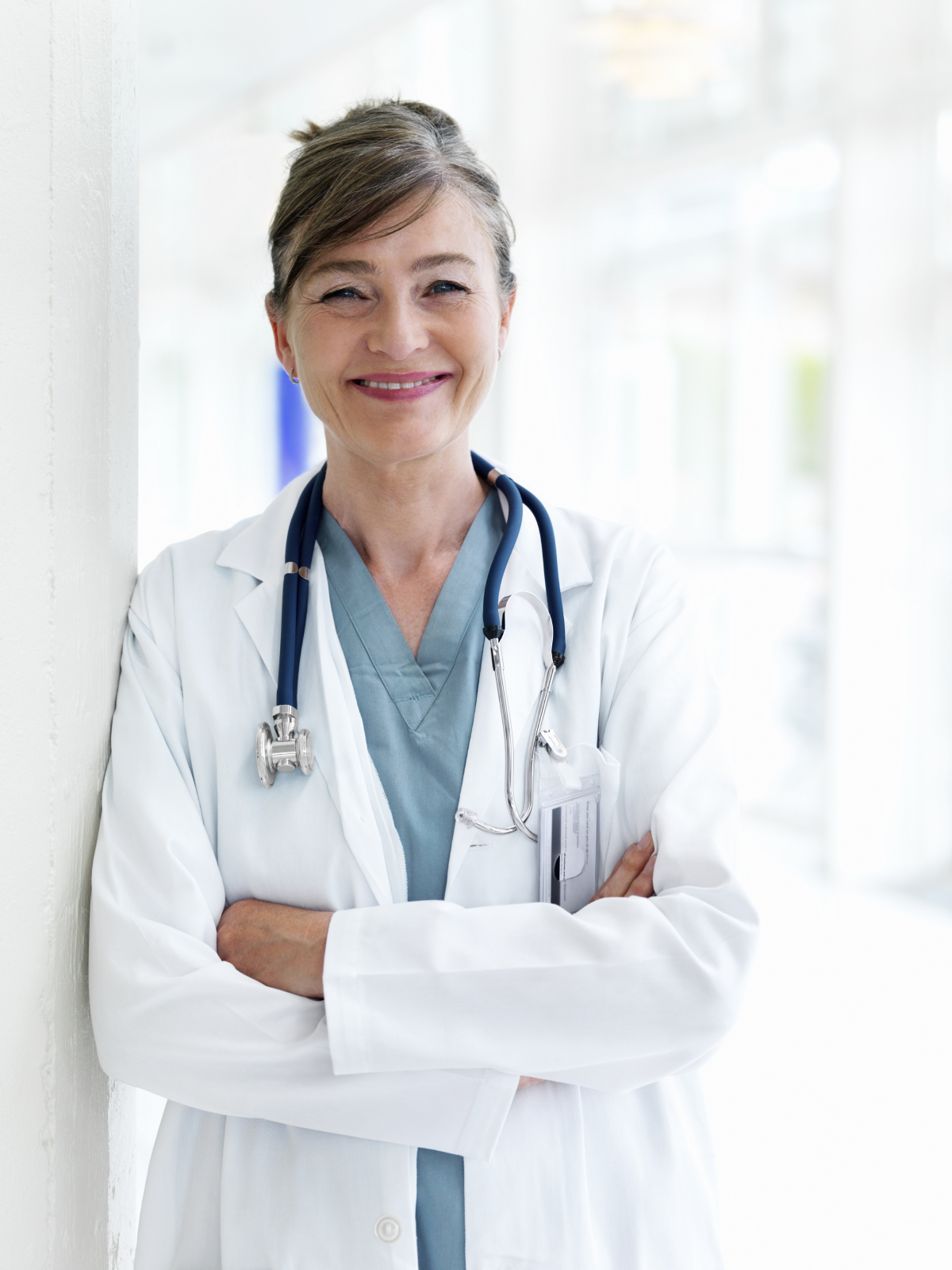 Happy female doctor looking at camera